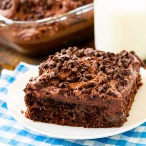 Slice of Chocolate Poke Cake on a plate.