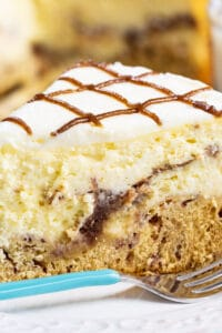 Slice of Cinnamon Roll Cheesecake on a plate.