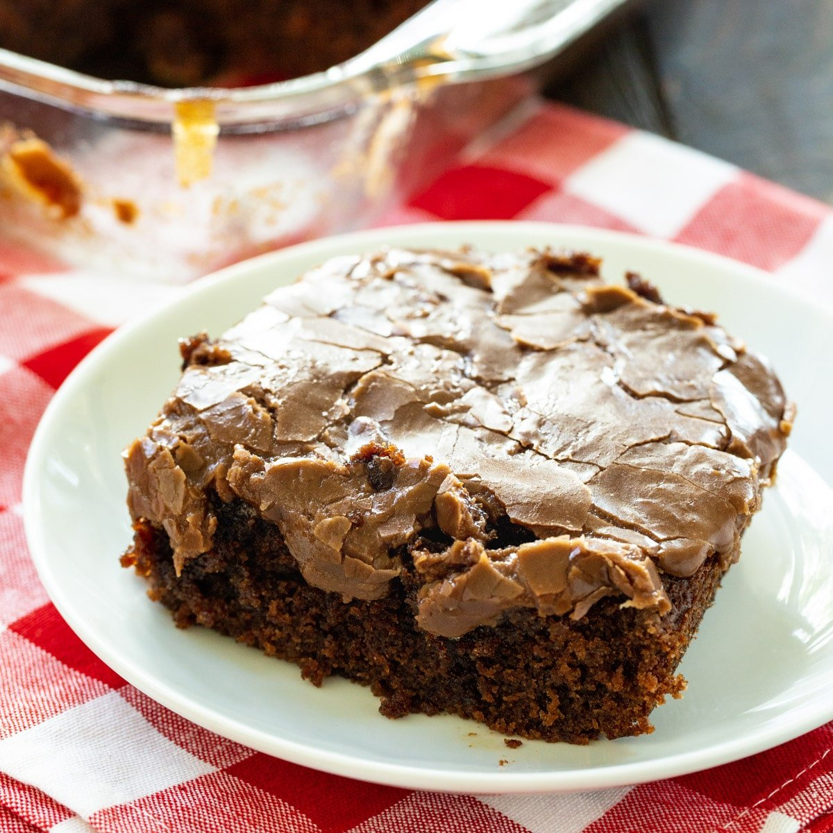 Slice of Classic Cocoa Cola Cake on a plate.