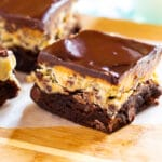 Cookie Dough Brownies on wooden cutting board.