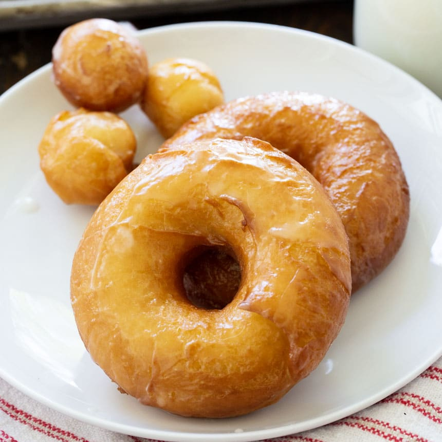Two doughnuts on a plate.
