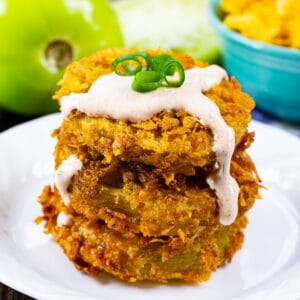 Stack of Cornflake Crusted Fried Green Tomatoes topped with Chipotle Mayo.