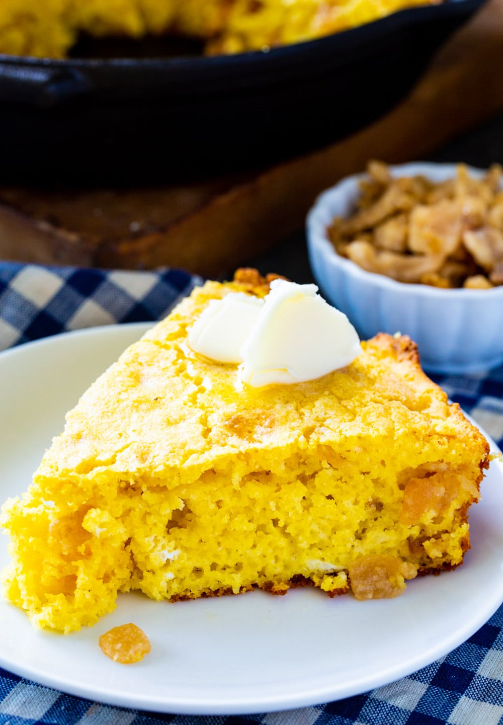 Cornbread with cracklings on a plate.