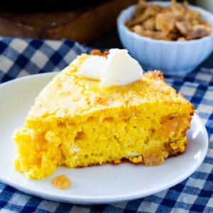 Slice of Crackling Cornbread topped with butter.