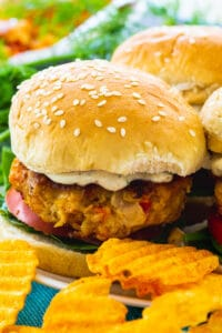 Crawfish Burgers on a plate with potato chips.