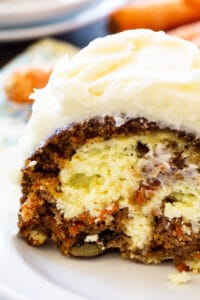 Slice of Cream Cheese Filled Carrot Cake on a plate.