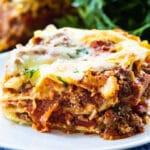 Slice of lasagna on plate.