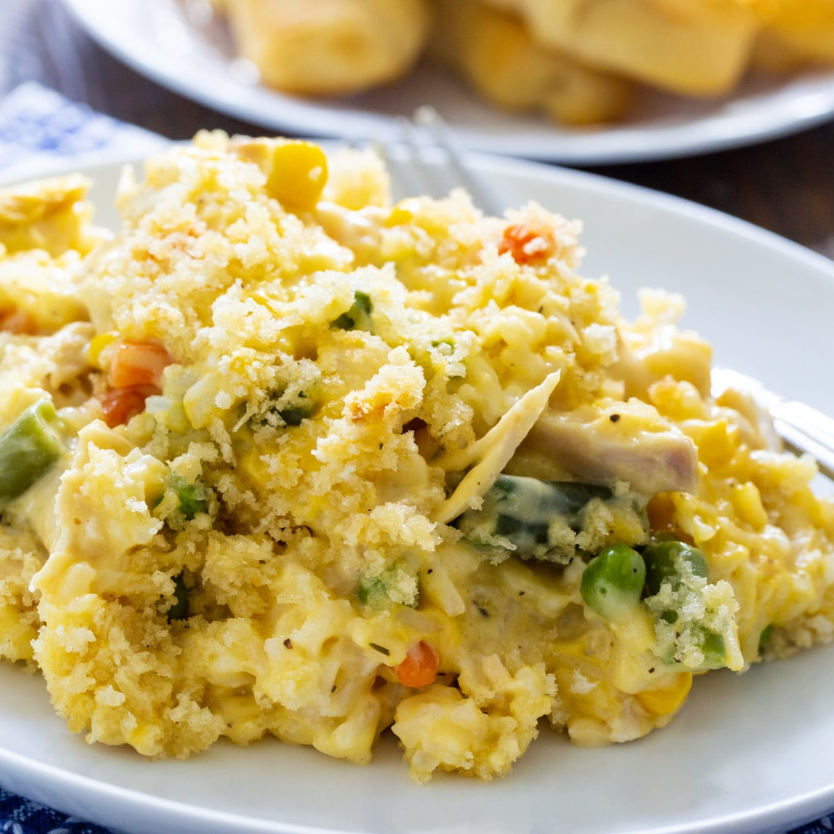 Creamy and Chicken Rice Casserole dished up on a plate.