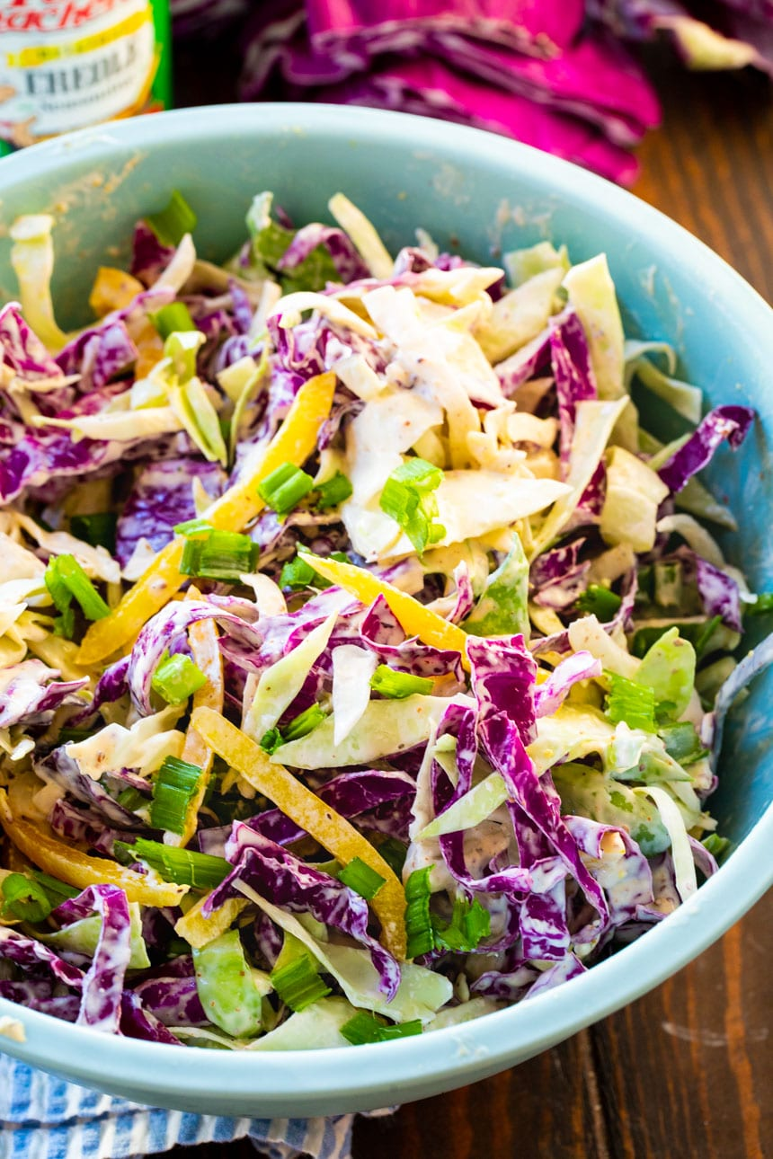 Coleslaw in a large blue bowl.