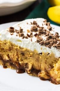 Slice of Creamy Peanut Butter Banana Pie on a plate.