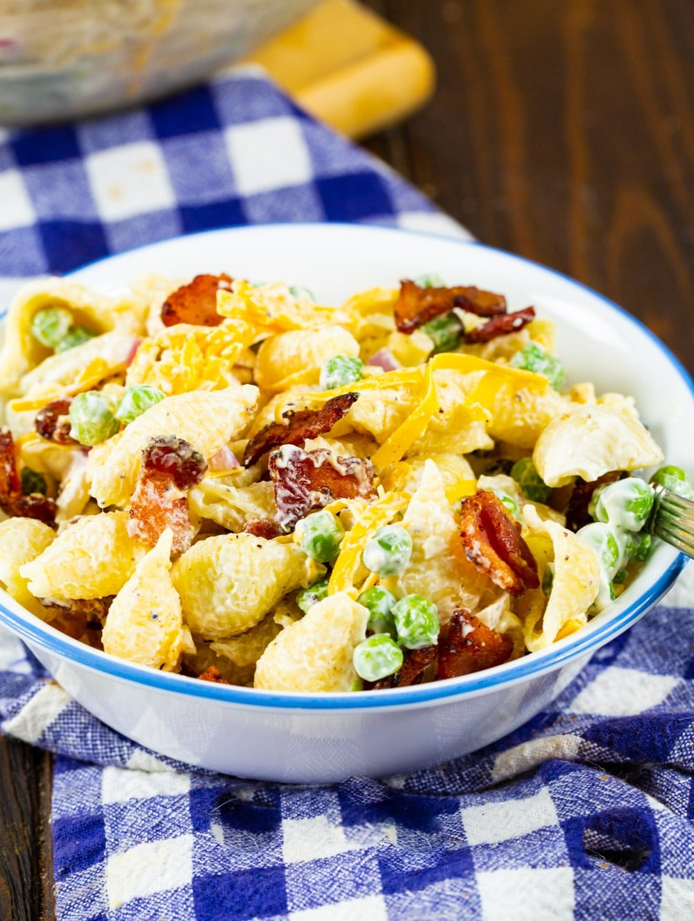 Creamy Pasta Salad with Peas and Bacon in a small bowl.