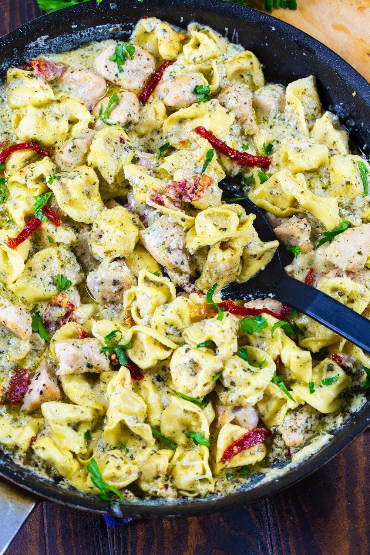 Pesto Tortellini with Chicken in a nonstick pan.