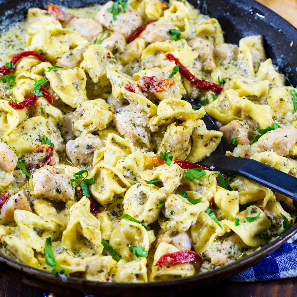 Creamy Pesto Chicken Tortellini in a large skillet.