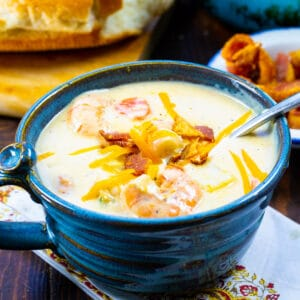 Creamy Potato Soup with Shrimp in a blue bowl.