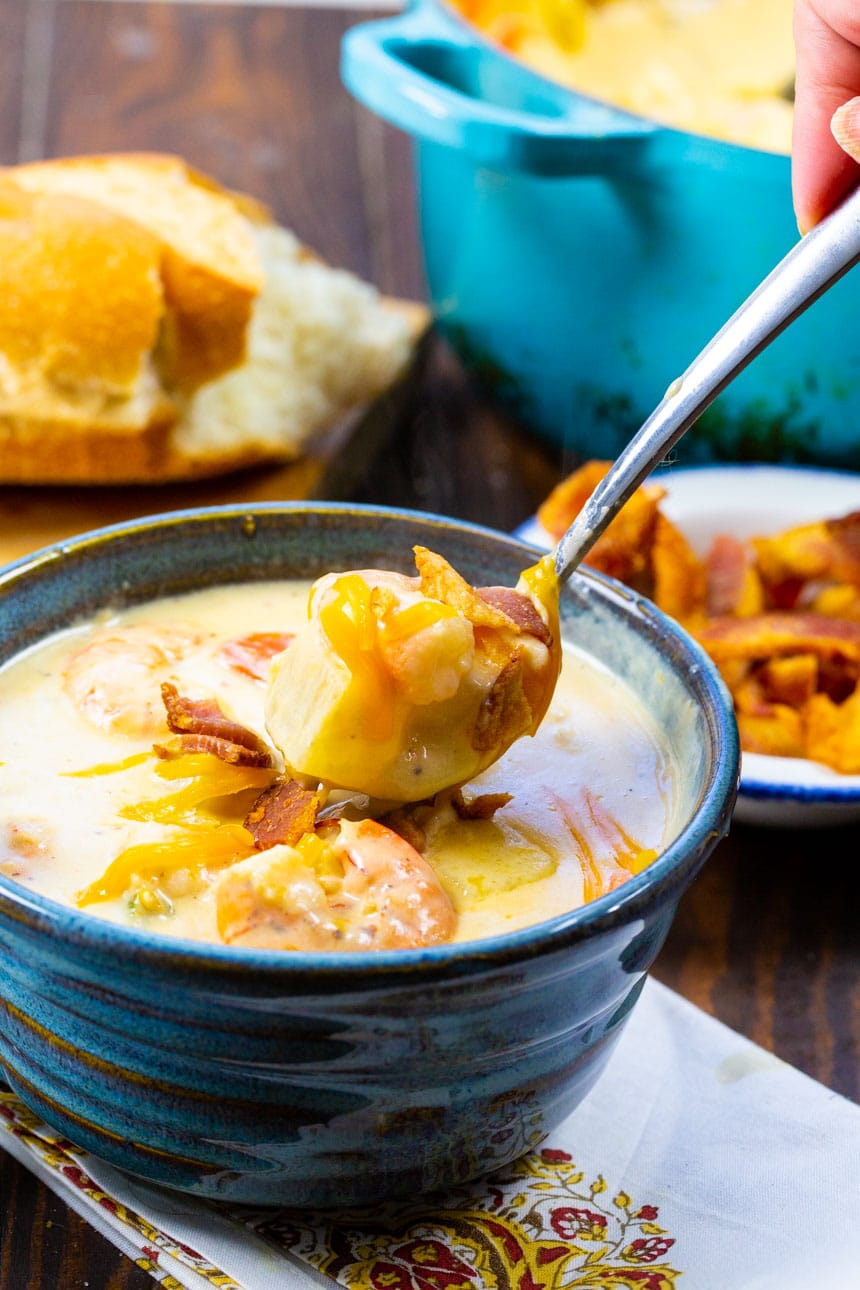 Spoon scooping Creamy Potato Soup with Shrimp.