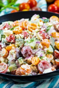 Creamy Tomato and Cucumber Chopped Salad in black bowl.