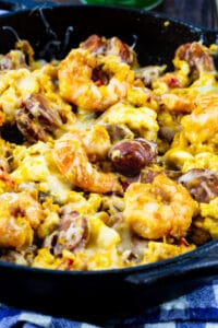 Cheesy Creole Breakfast Skillet in a cast iron skillet.
