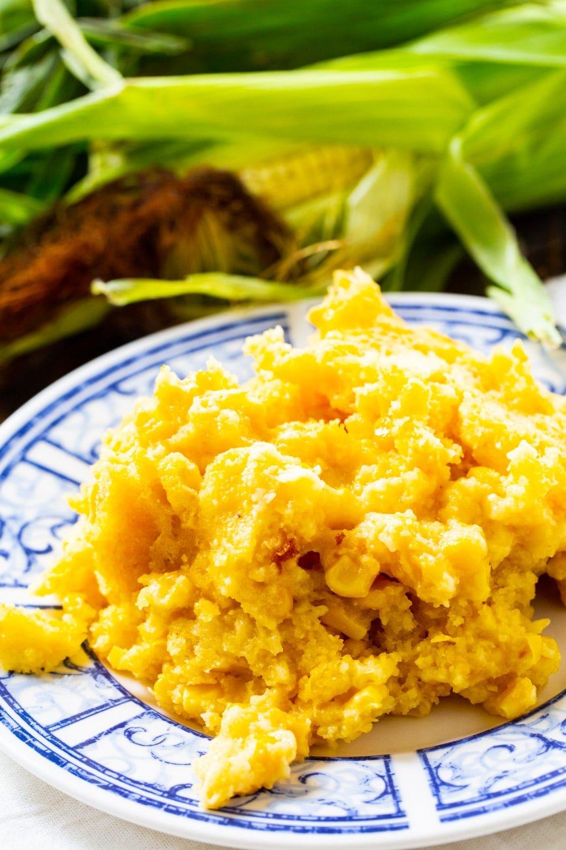 Serving of Crock Pot Corn Casserole on a plate.