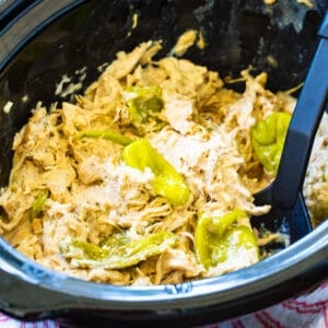 Crock Pot Creamy Mississippi Chicken in black slow cooker.