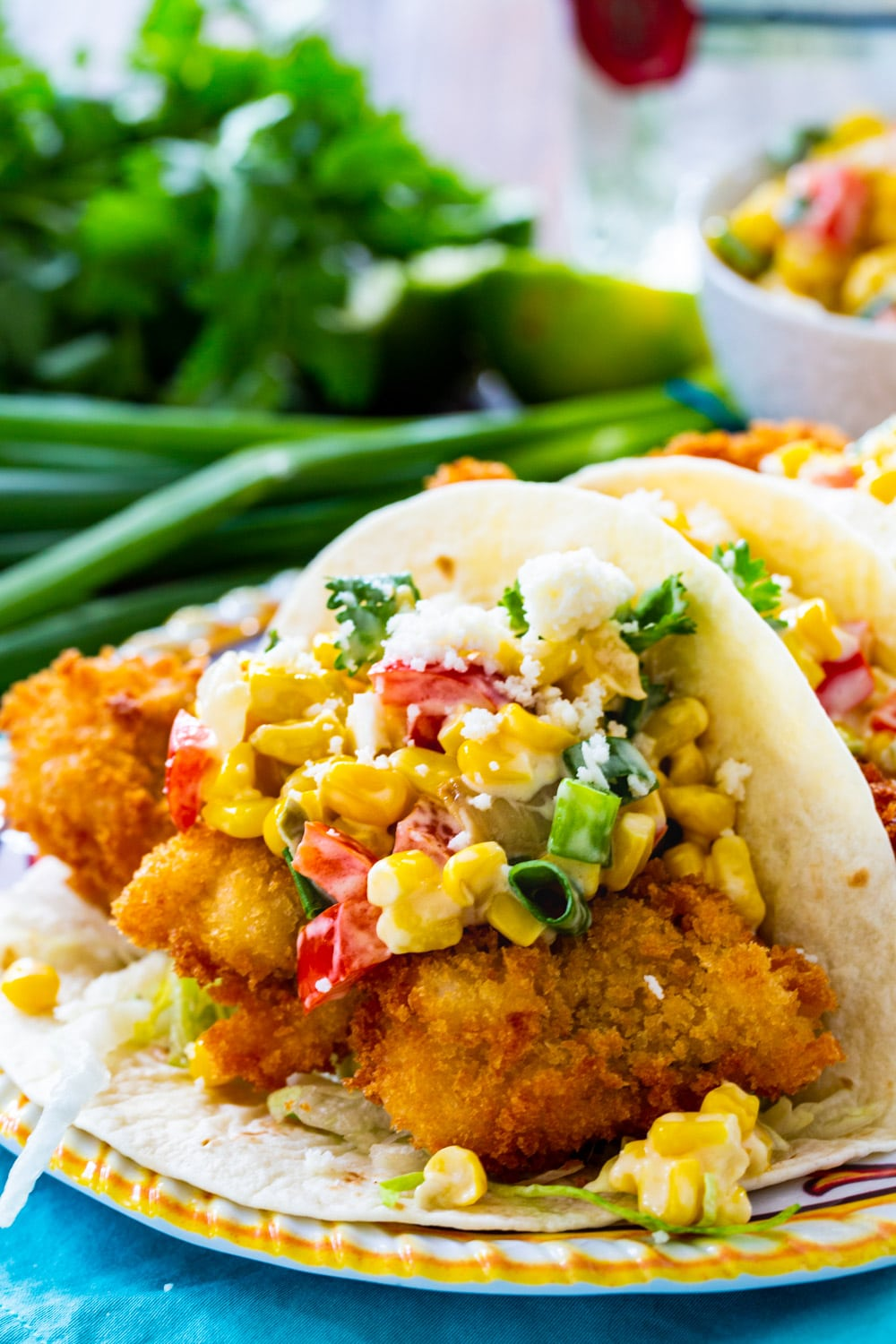 Crunchy Catfish Tacos with Tequila Creamed Corn on a plate.
