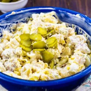Dill Pickle Potato Salad in a blue bowl.