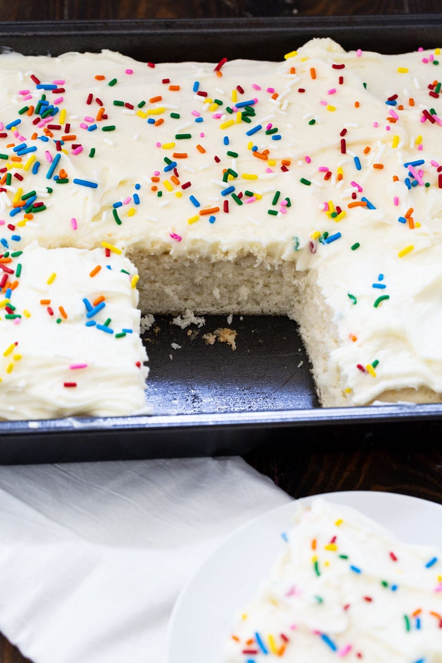 Sheet cake in baking dish with 1 slice cut out.