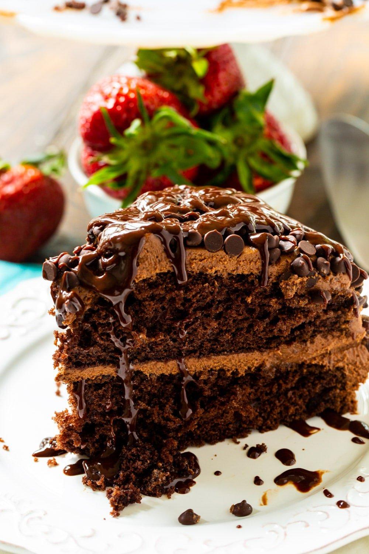 Slice of chocolate cake with fresh strawberries.