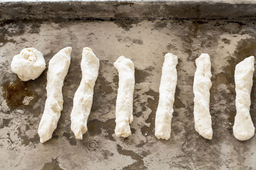 Biscuit dough stretched into ropes.