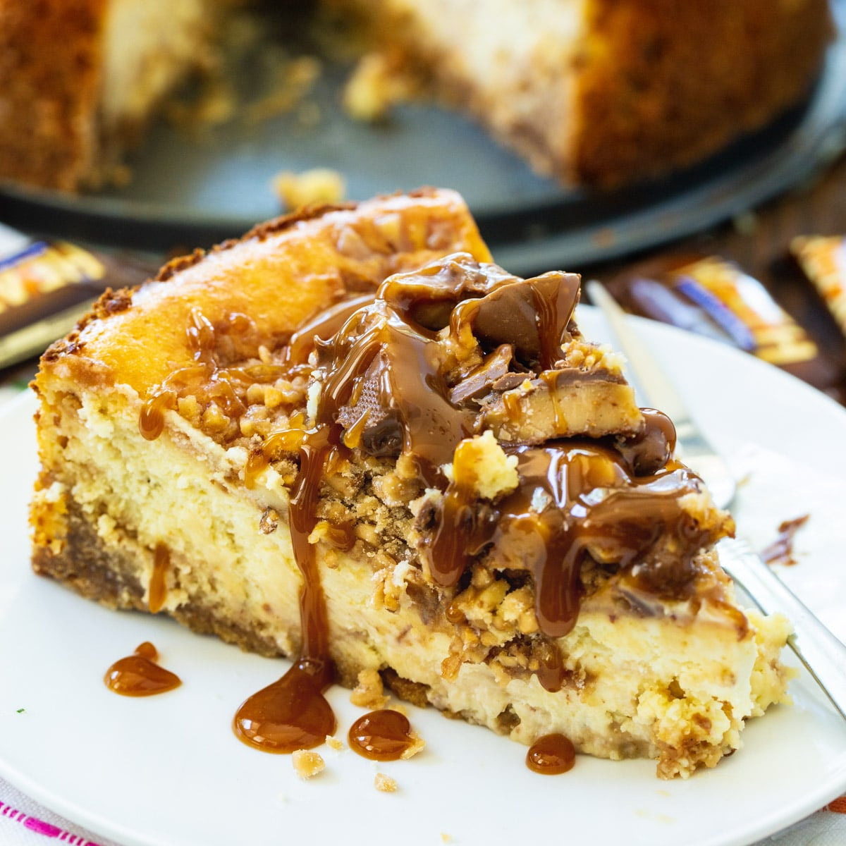 English Toffee Cheesecake slice on a plate.
