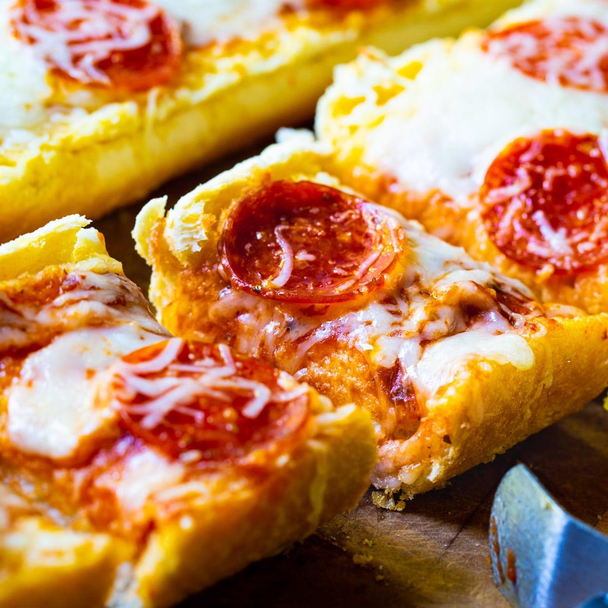 Garlic Bread Pizza cut into slices.