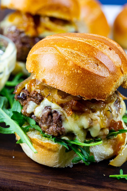 Close-up of French Onion Burgers on brioche bun.