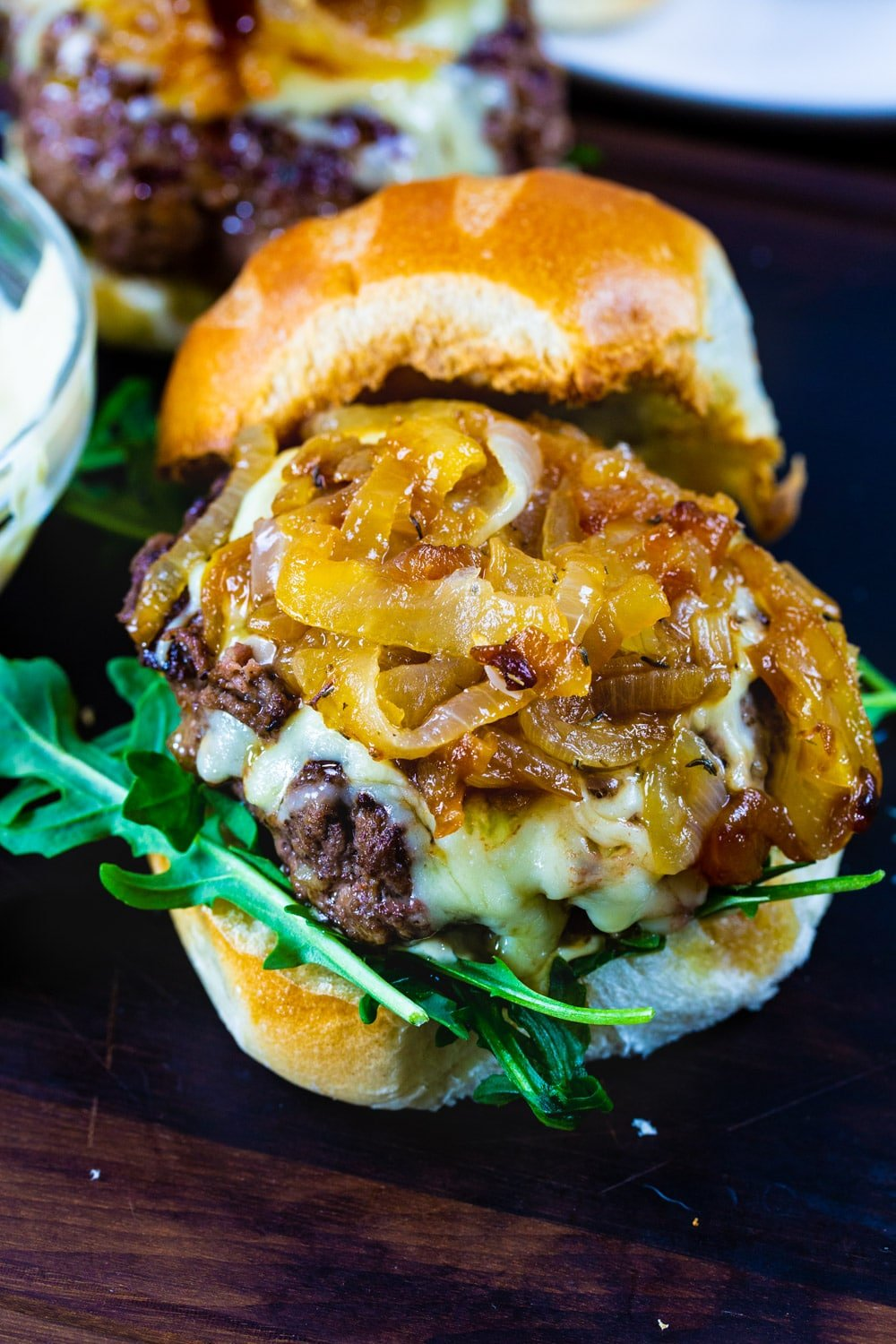 Caramelized onions on top of burger.