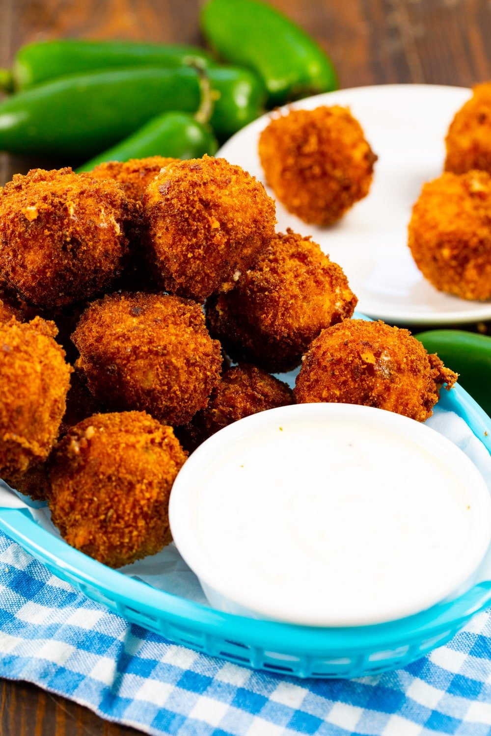 Jalapeno Popper Bites in a basket with a bowl of ranch dressing.