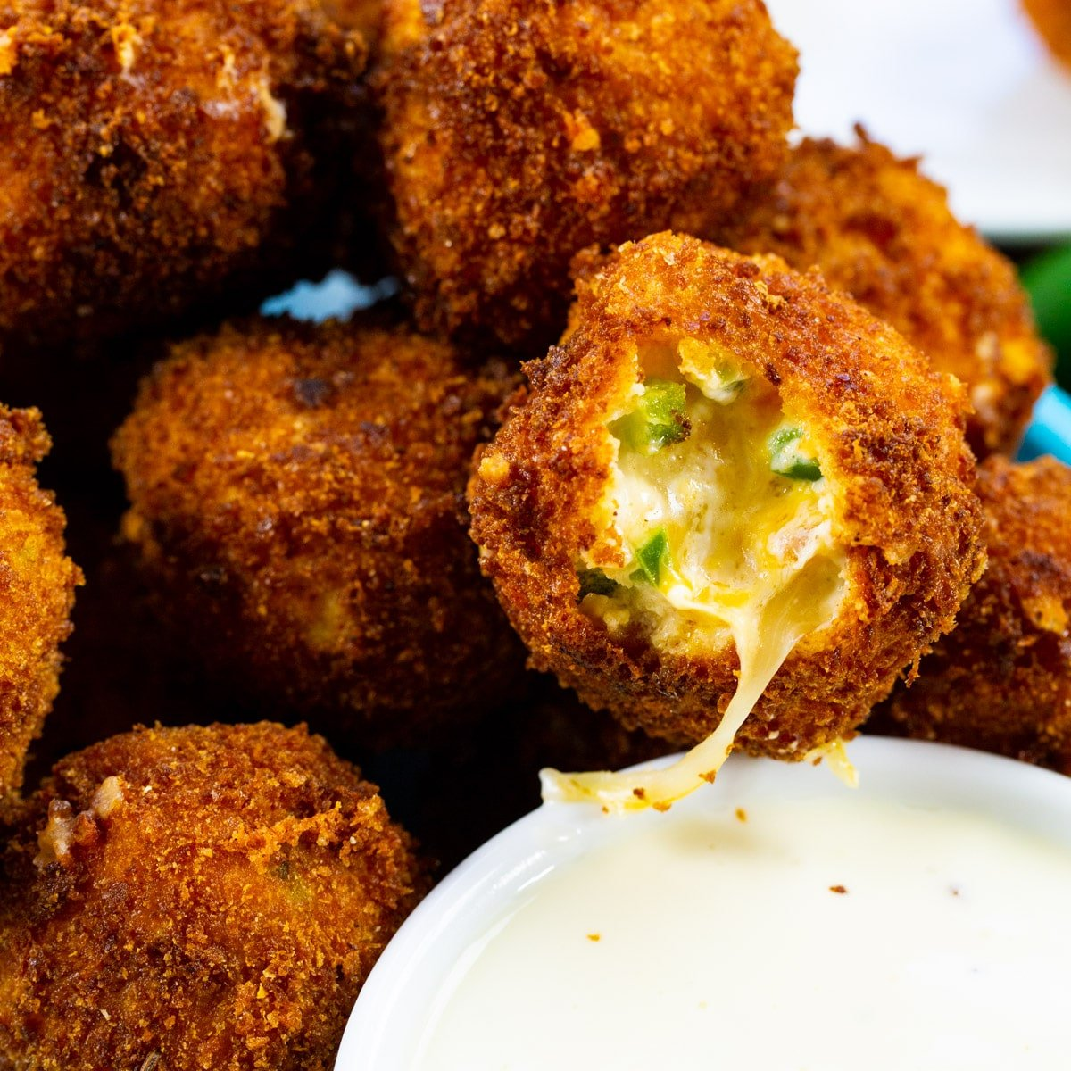 Fried Jalapeno Popper Bites with bite bitten out.