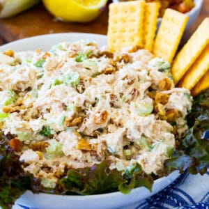 Golden Chicken Salad in a bowl with club crackers.