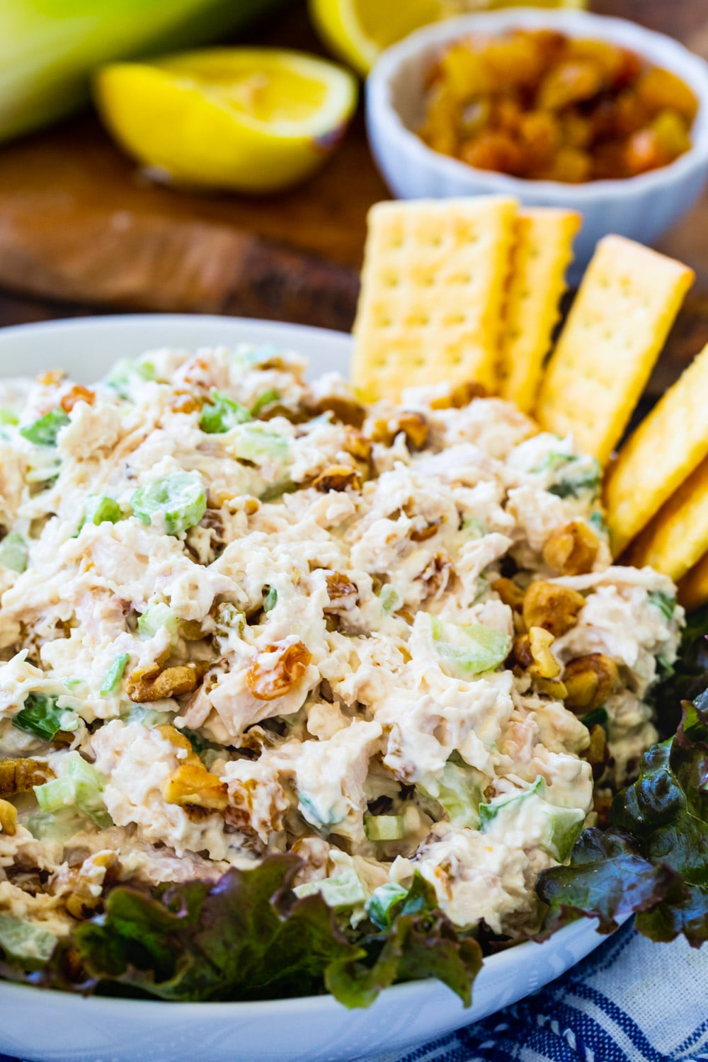 Chicken Salad on a bed of lettuce in serving bowl.