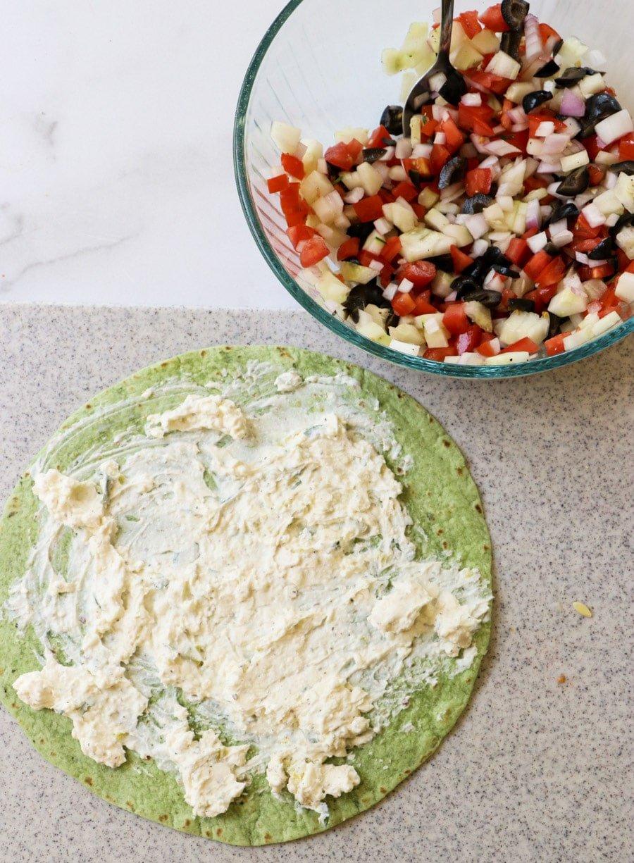 Spread cream cheese mixture on tortilla.