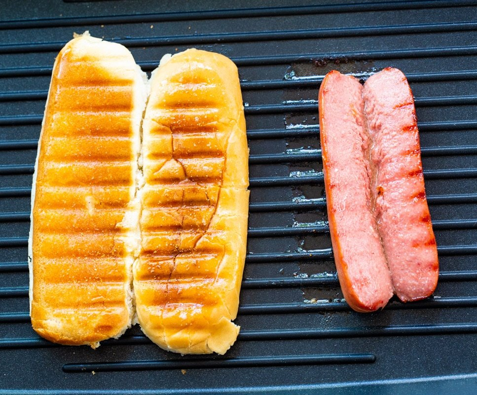 Grilled bun and a grilled hot dog.