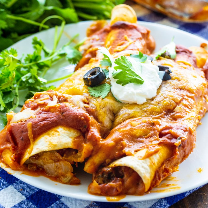 Two Beef Enchiladas on a white plate with cilantro
