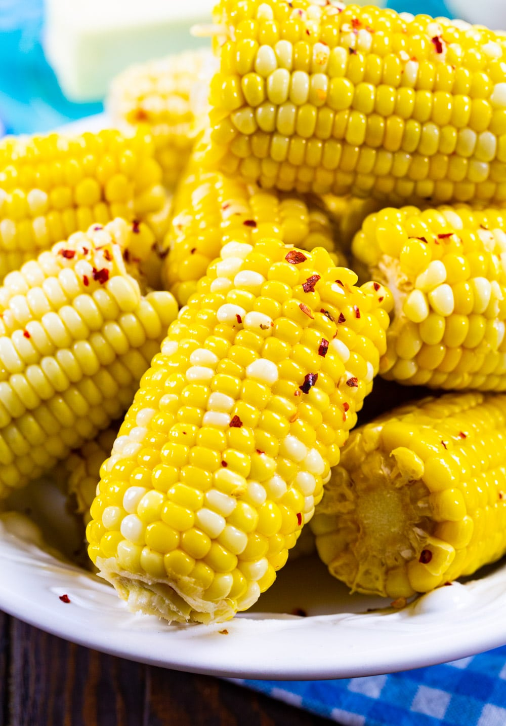 Southern Hot Honey Butter Corn piled up on a serving plate.