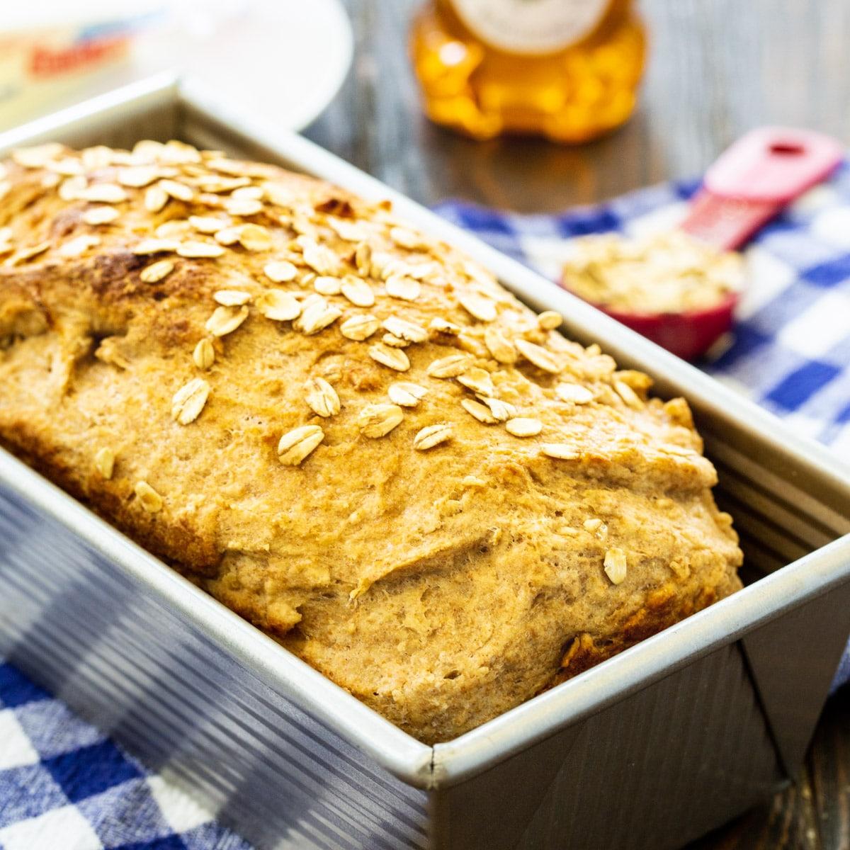 Honey Oat Wheat Bread in a loaf pan.
