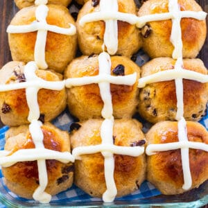 Nine Hot Cross Buns on a baking sheet.