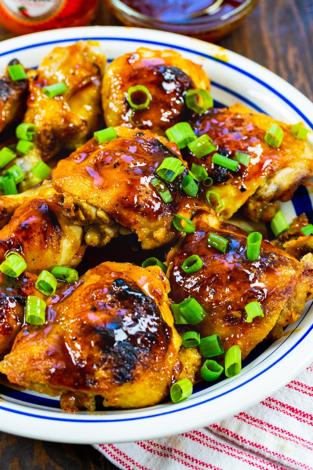 Cooked chicken topped with green onions.