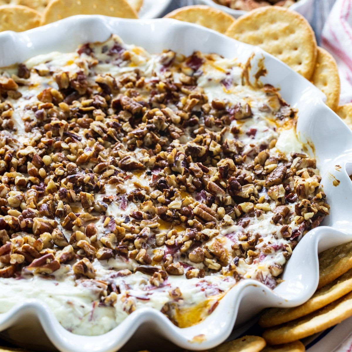 Hot Pecan Beef Dip surrounded by crackers.