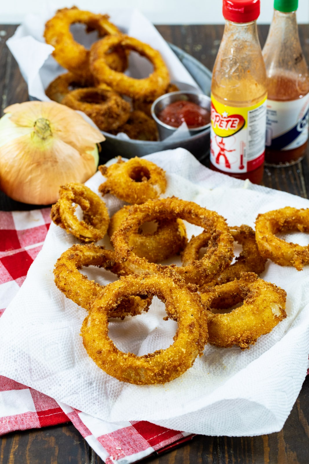 Crispy Spicy Fried Onion Rings and 2 bottles of hot sauce.