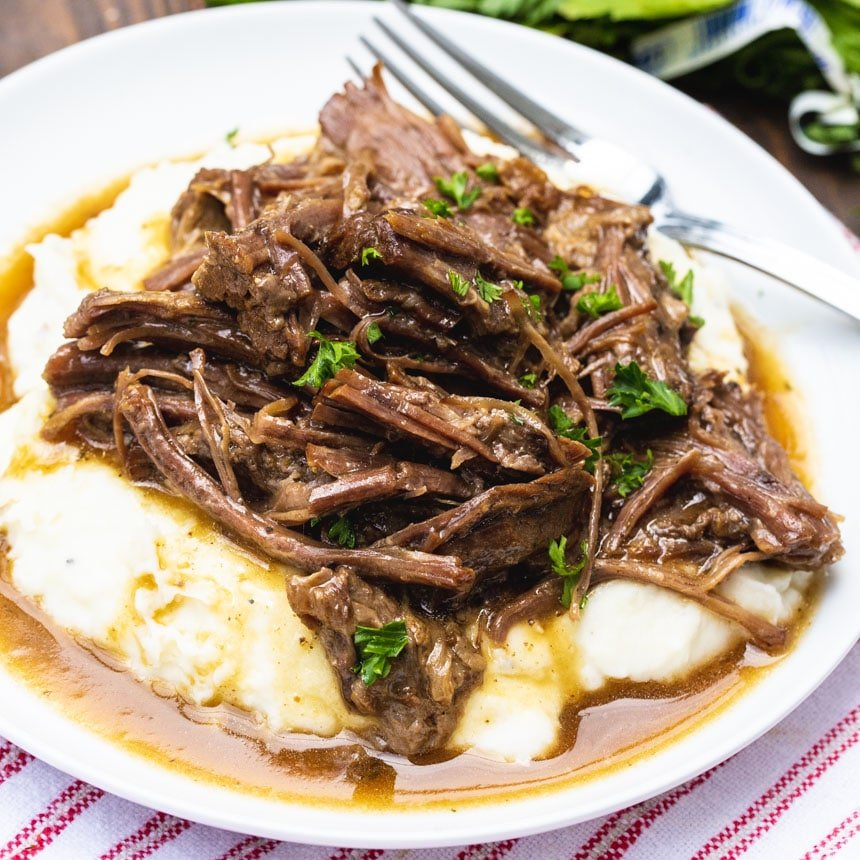 Instant Pot Pot Roast served ver mashed potatoes.