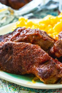 Instant Pot Country Style Ribs on plate with mac and cheese.