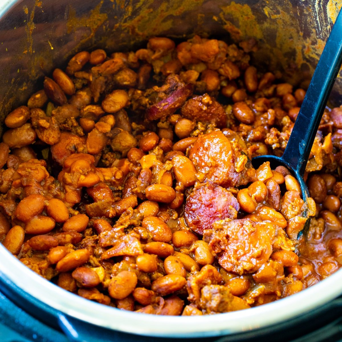 Instant Pot Cowboy Beans in Instant Pot with spoon.