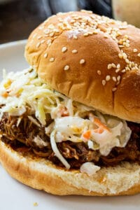Instant Pot Pulled Pork on a bun with coleslaw.