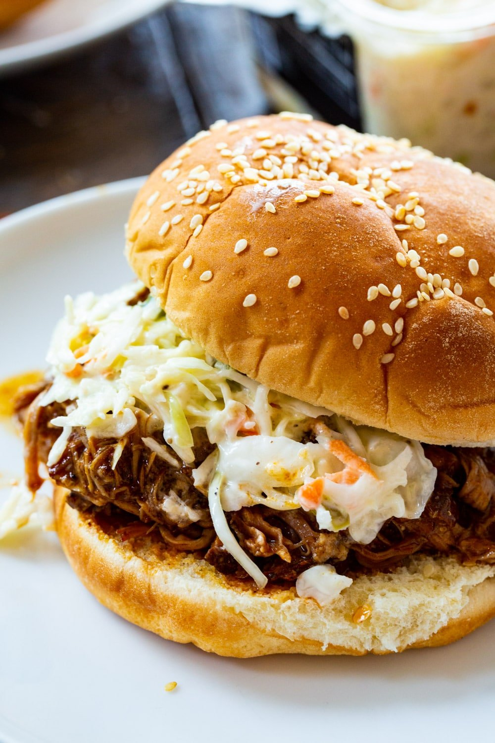 Pulled Pork on a bun with coleslaw.
